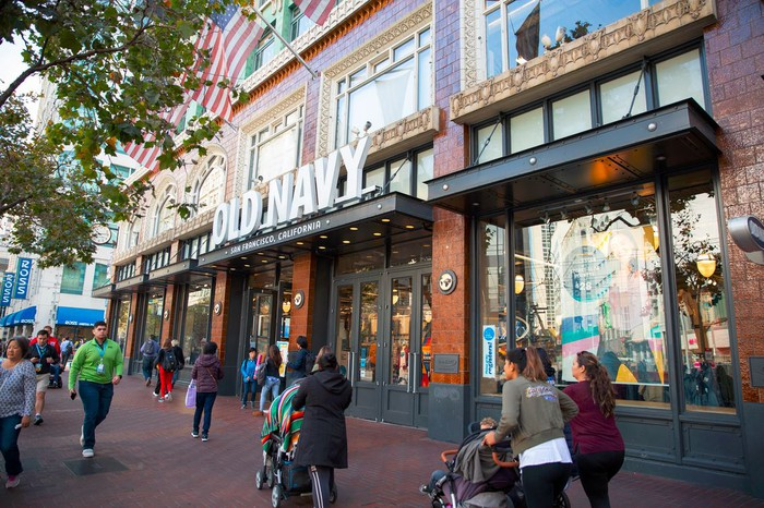 People walking in front of an Old Navy store in San Francisco.
