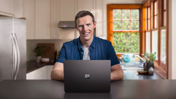 A man uses Microsoft's Surface Laptop 2.