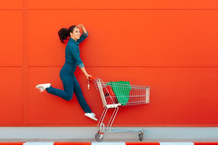 A woman with a grocery cart