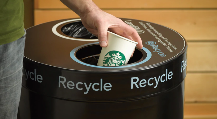A Starbucks cup being recycled.
