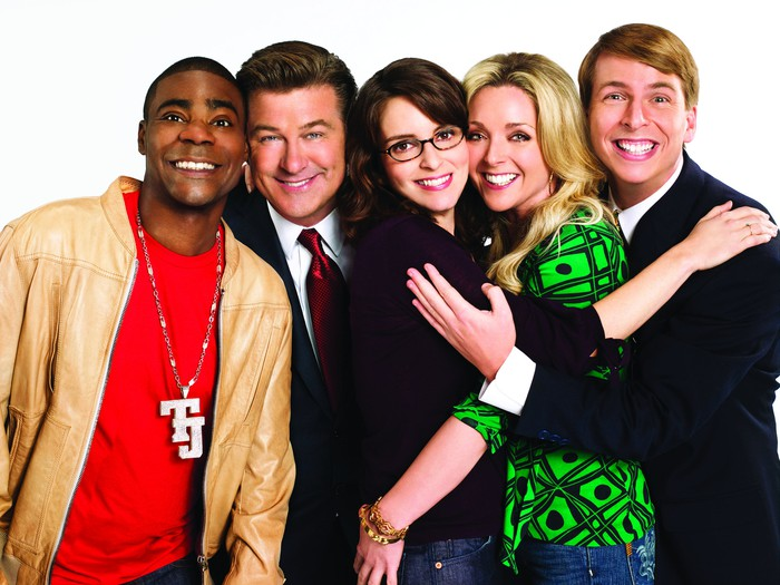 The cast of NBC's 30 Rock in an awkward embrace.