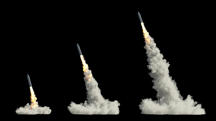 A photo illustration of three large missiles launching in a row.