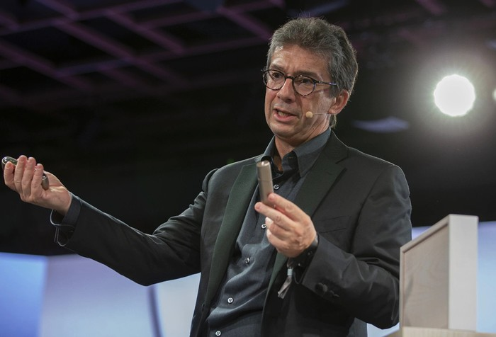 PMI CEO André Calantzopoulos presents the new iQOS device.