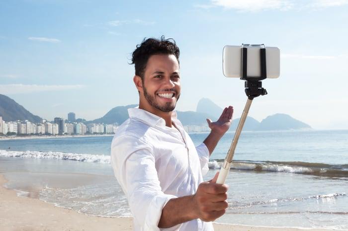 A Brazilian man takes a selfie on the Copacabana beach in Rio de Janeiro.