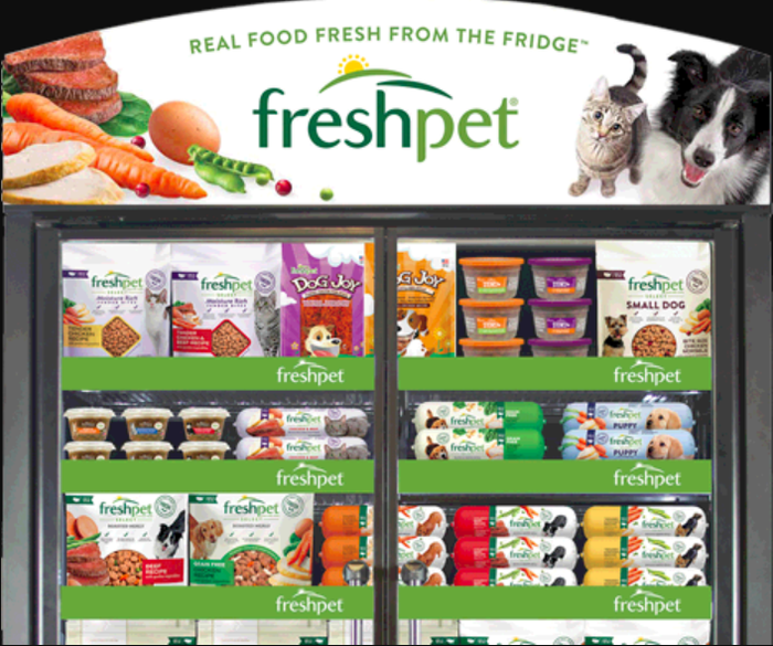 A Freshpet refrigerator fully stocked with Freshpet dog and cat good.