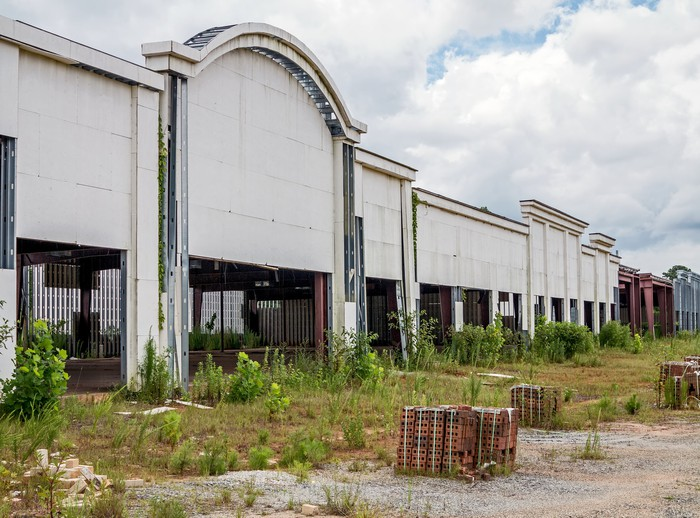 The facade of an abandoned shopping mall