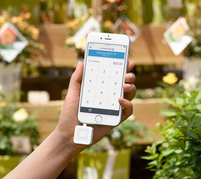 Square's mobile card reader attached to a smartphone.