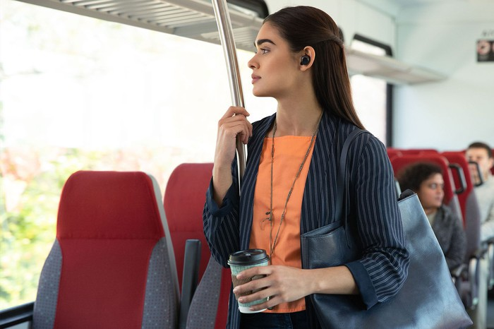 Woman wearing Echo Buds on a bus