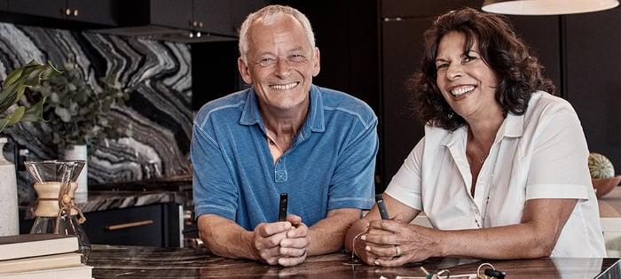 Older couple holding Juul electronic cigarettes