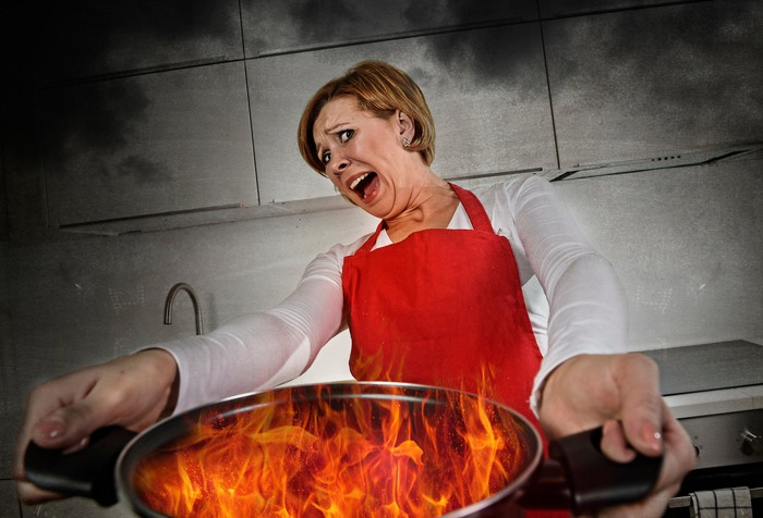 Woman holding a flaming pot