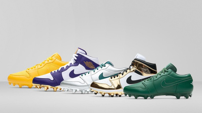 Five Nike Jordan cleats lined up next to one another.