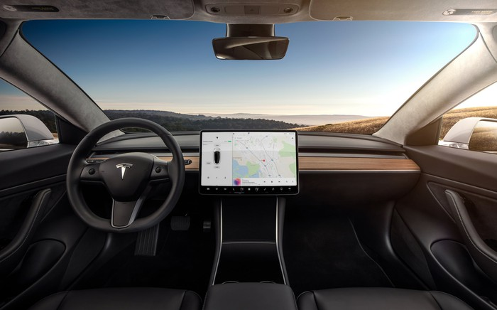 An interior view of the Model 3, centered on its 15-inch touch display