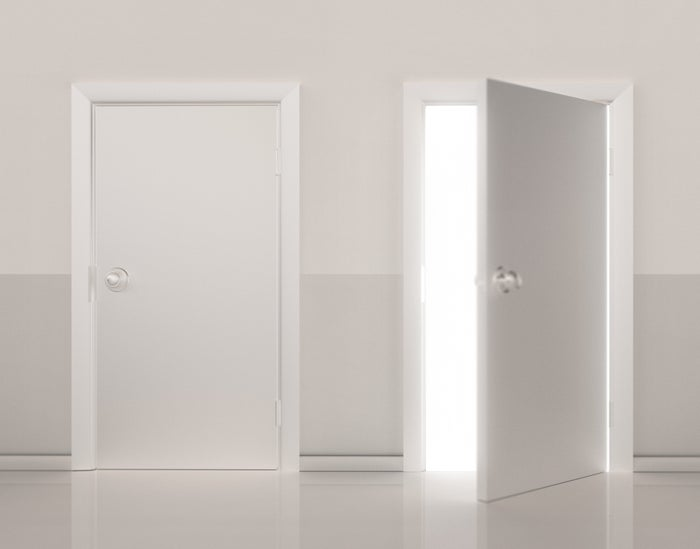 Two white doors with one of them opened.