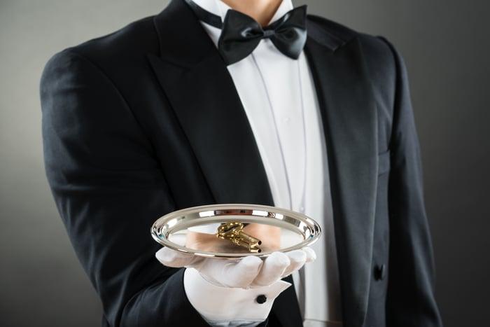Waiter holding tray with key