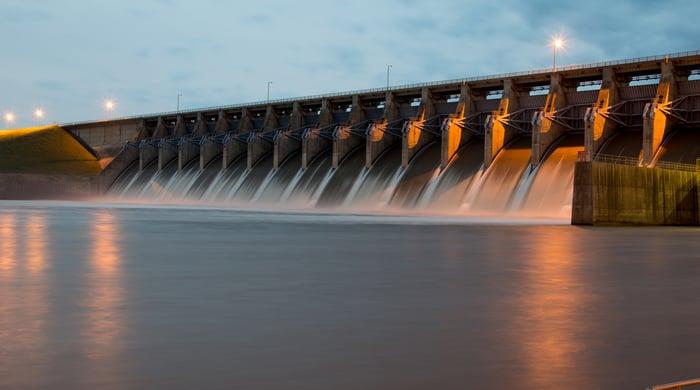 A hydropower dam at twilight.