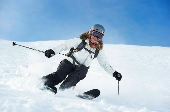 A skier makes a run down the mountain.