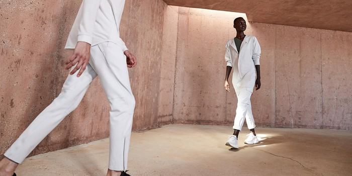 Two models wearing white clothing from Lululemon's new streetwear brand