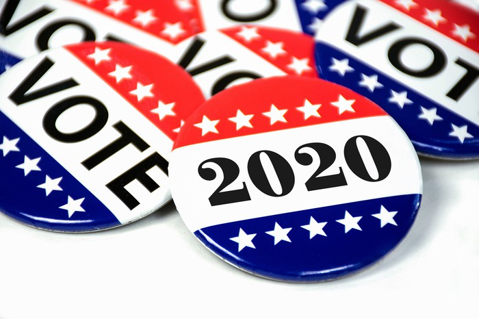 """Election pins read """"vote"""" and """"2020"""""""
