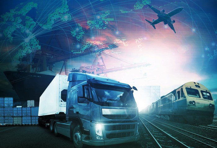 International trade represented by truck, train, plane, and ship