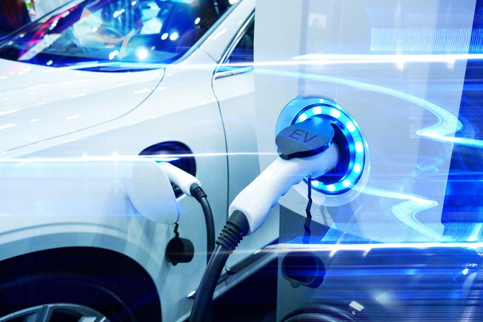 An electric automobile being charged
