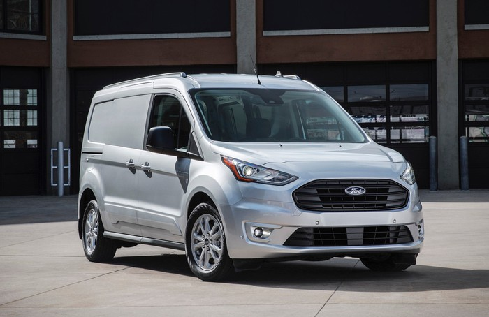 A silver Ford Transit Connect, a compact commercial van.