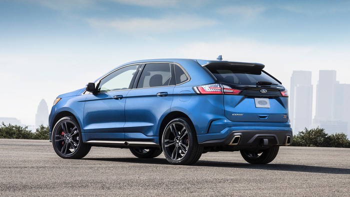 A blue Ford Edge ST, a high-performance midsize crossover SUV.