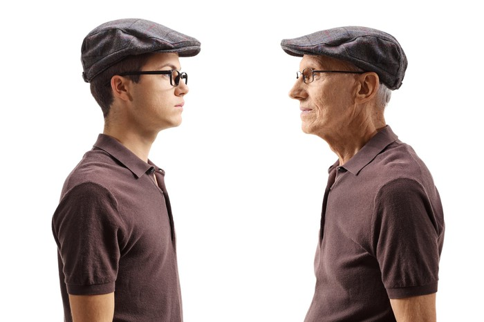 Old man looking at young man dressed identically