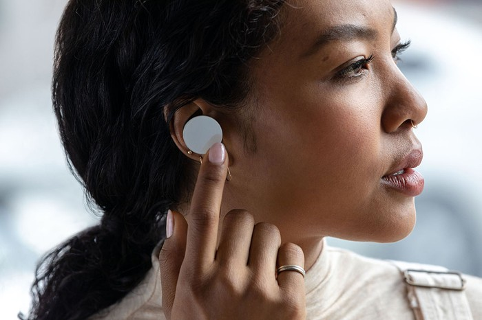 Woman wearing Surface Earbuds