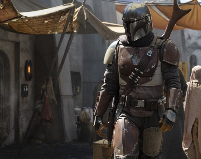 A man in a Boba Fett-like suit of armor is seen in a promotional shot for The Mandalorian.