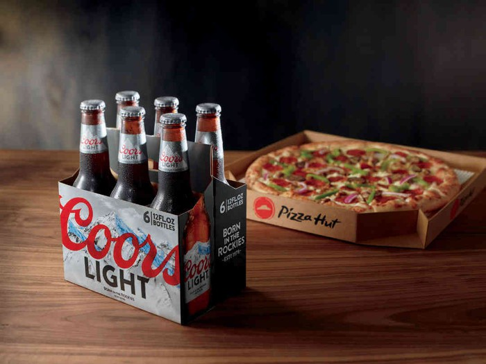 Six-pack of Coors Light and a Pizza Hut pizza