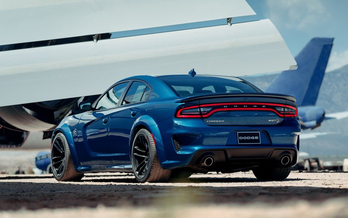 A blue 2020 Dodge Charger SRT Hellcat Widebody, a big high-performance sedan with aggressive styling.