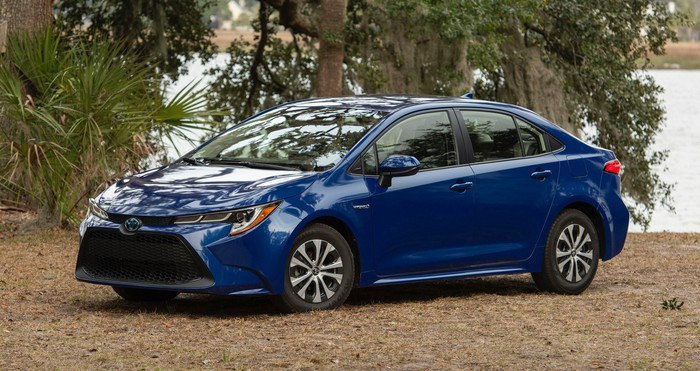 A blue 2020 Toyota Corolla Hybrid, a compact four-door hatchback.