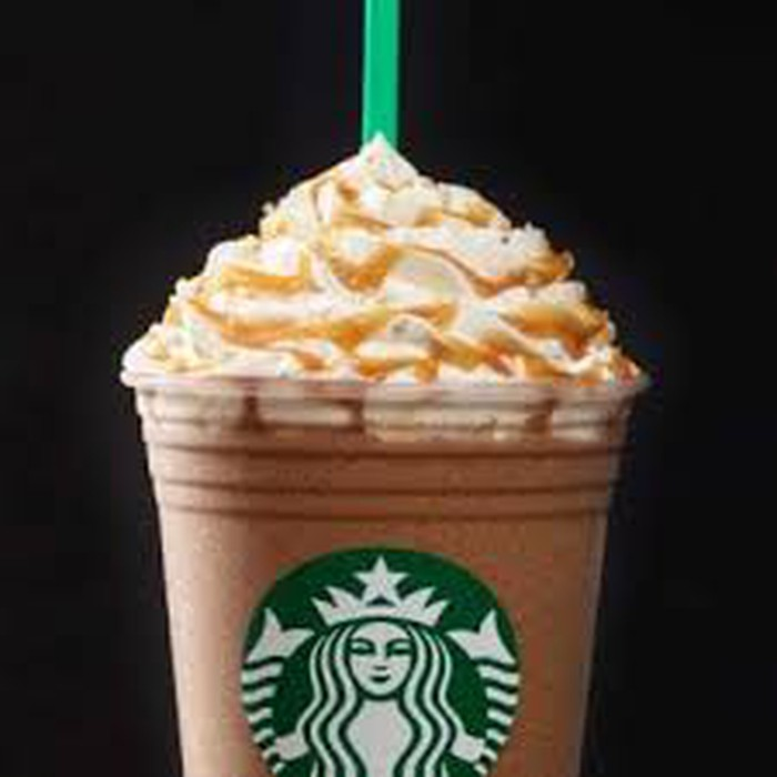 A Starbucks frappuccino topped with whipped cream.