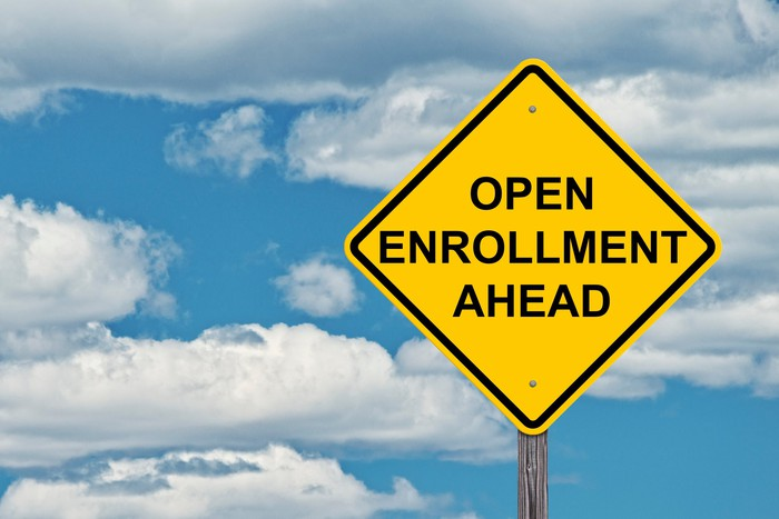 Diamond-shaped sign reading Open Enrollment Ahead