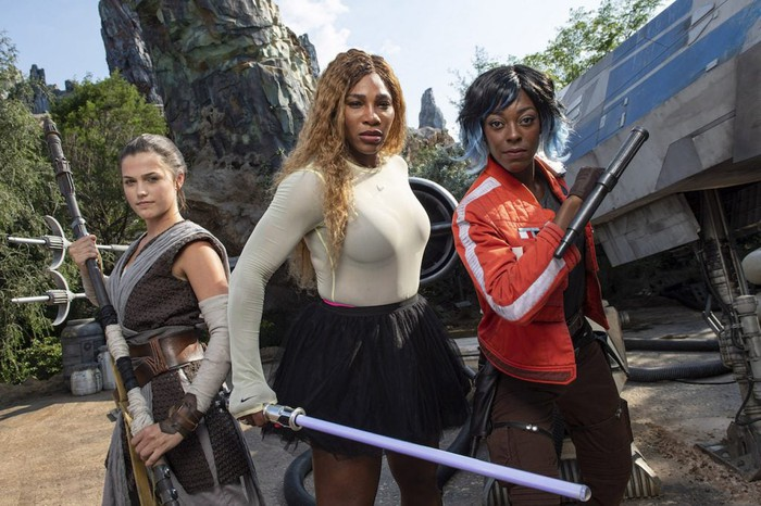 Serena Williams joins costumed characters for Rey and Vi Moradi at Star Wars: Galaxy's Edge at Disney World.