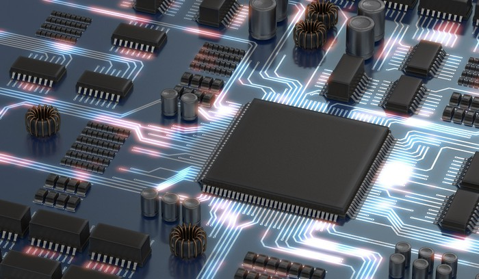 graphic of an electric circuit with a processor and memory and glowing illumination of signals running between them.