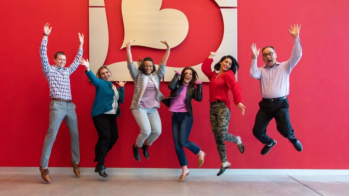 Burlington employees jumping in the air