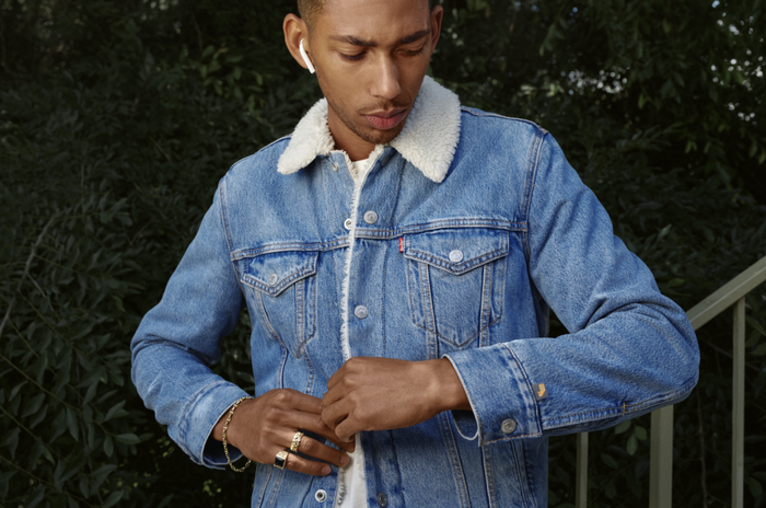 A young man wearing a Levi's trucker's jacket.