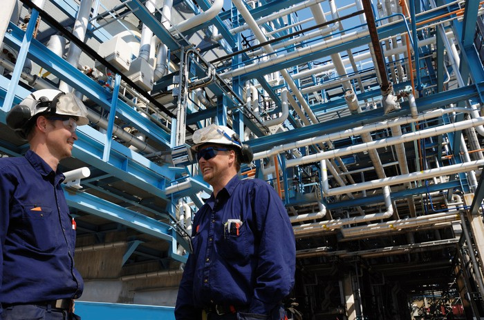 Two men talking at an energy processing plant