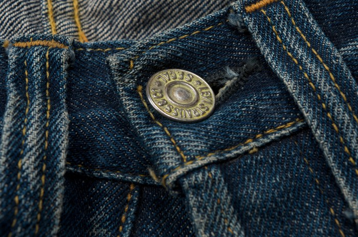 Close-up of a button on a pair of jeans