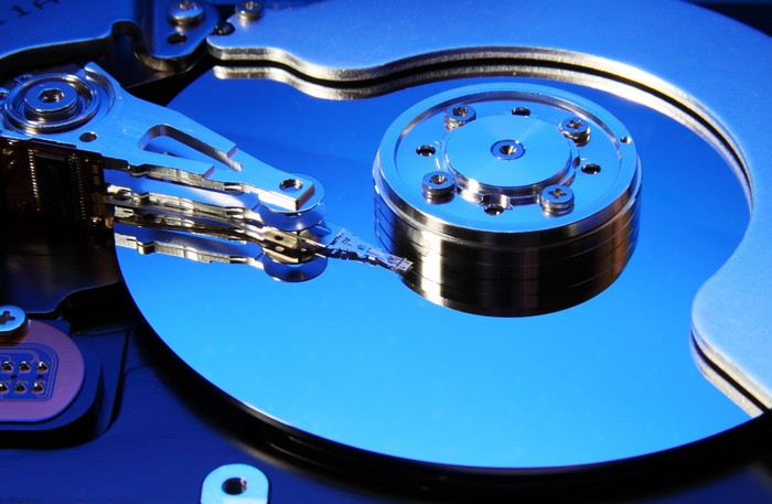 A closeup of a hard disk bathed in blue light.