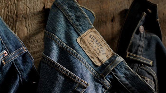 Levi Strauss vintage blue jeans hanging on a wall