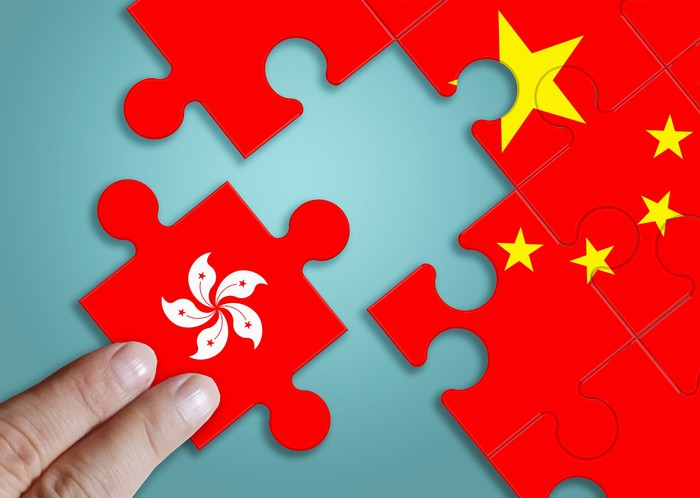 A jigsaw puzzle of the Chinese flag with a piece representing Hong Kong removed