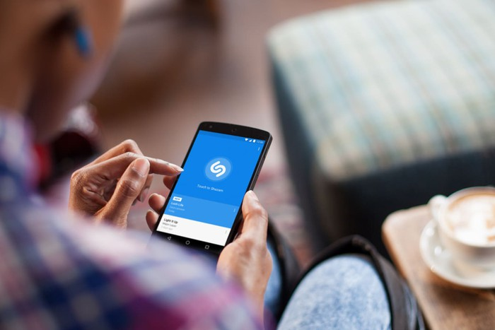 Person using Shazam app on a phone