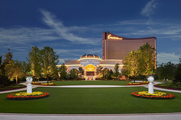 Wynn Encore resort, with grass and pillars against a darkening blue sky.