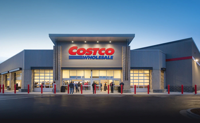 The front of a Costco Store at dusk