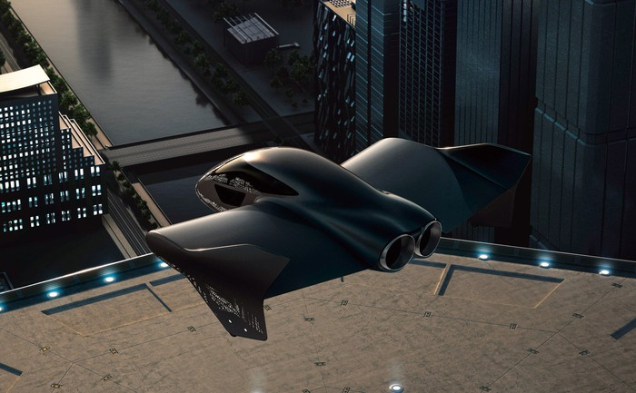 A futuristic passenger drone is shown hovering over a landing pad high above the ground in a city.