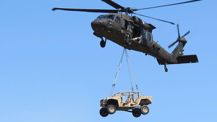 Helicopter carrying a military vehicle