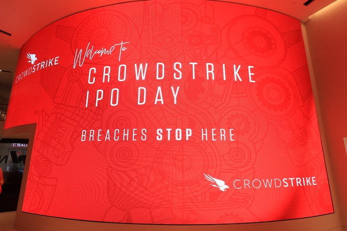 Red screen with Crowdstrike IPO day slogan and other text.