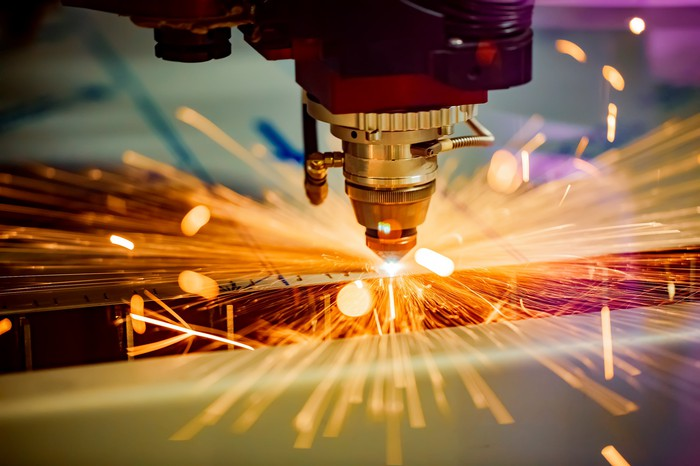 A metal-cutting laser sends out sparks